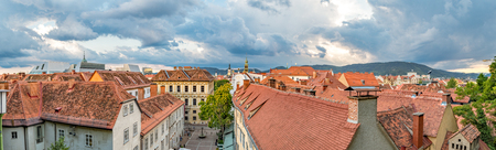 Panorama of the old town of Graz seen from Castle Hill during a cloudy sunset