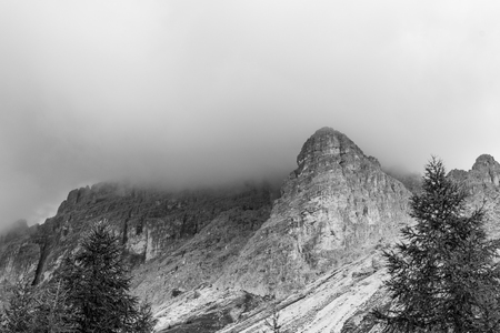 Mountain peak in black and white, dramatic, thick storm clouds. Cadins of Misurina, Dolomites, Italy