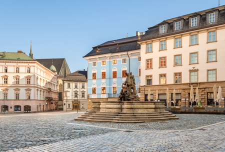 Olomouc old town with Caesar's Fountain and historic buildings on Horni Namesti (Upper Square in Czech) in the morning Фото со стока