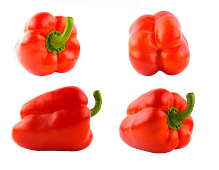 Four red sweet peppers set different sides photo