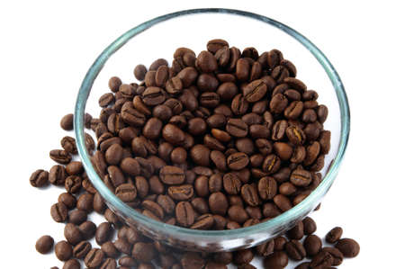 Brown coffee beans inside and around glass jug photo