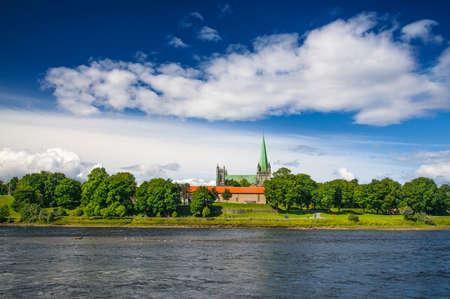 soapstone: Nidarosdomen - Nidaros Cathedral near Nidelva river landscapein Trondheim, Norway