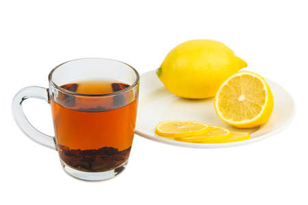 cold cure: Tea and lemon as cure for cold isolated on white background Stock Photo