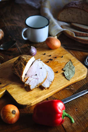 roast meat: Delicious roast turkey meat with bay leaf, pepper and garlic on old cutting board, Vintage country table Stock Photo