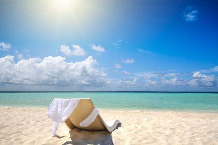 Single chair on the white sand beach. Vacation concept Stock Photo