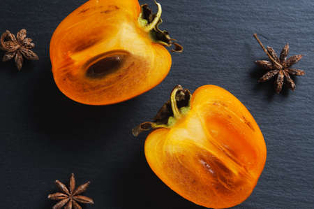 Top flat view: anise sta and persimmon