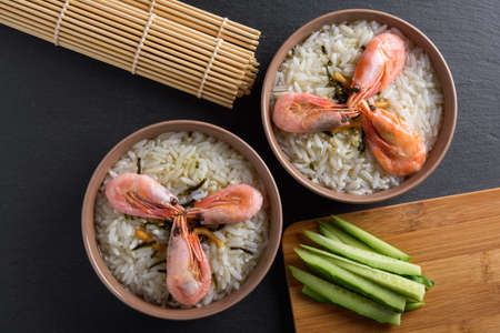 Top view of two portions of ochazuke or chazuke with shrimps