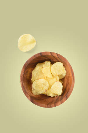 Top view of bowl with potato chips isolated