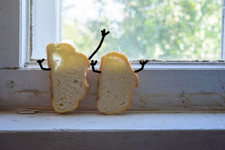 Two bread slices at rustic village windowsill