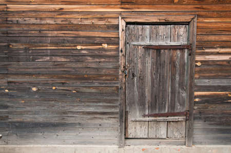 Front view: old rustic wooden wall and door