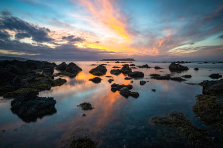 Long exposure of a Sunset on the coast of Plimmerton New Zealand Stock Photo