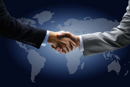 treaty: Handshake with map of the world in background  Stock Photo
