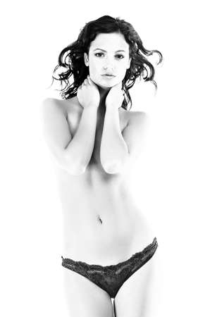 Naked young woman covering her breast with hands over white background  photo