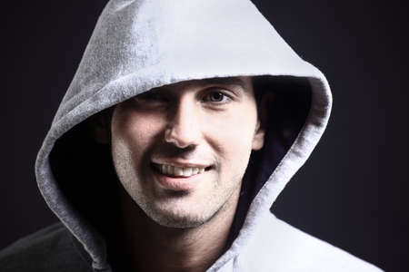 head wear: cool b-boy in light jacket against black background