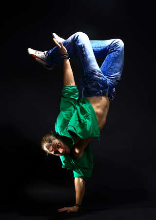 stylish and cool breakdance style dancer posing photo