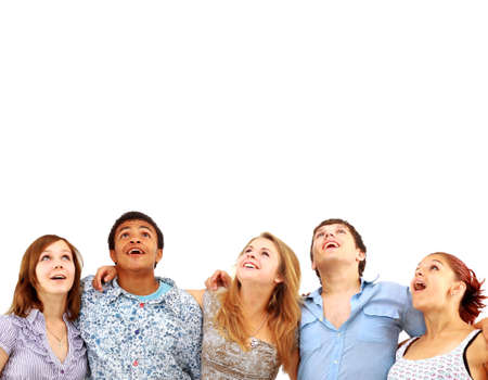 looking upwards: CLoseup portrait of many men and women smiling and looking upwards against white background  Stock Photo