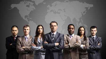 multinational: Businessmen standing in front of an earth map  Stock Photo