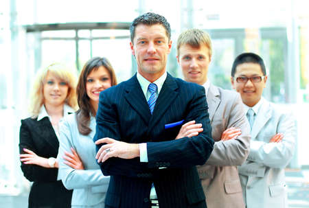 Confident mature business man with colleagues at the background  Stock Photo - 11146863