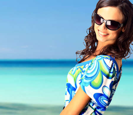 bright picture of lovely brunette woman at the sea  Stock Photo - 11147050