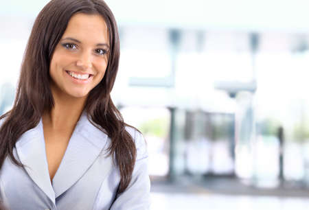 A young, pretty caucasian business woman at office building  Stock Photo