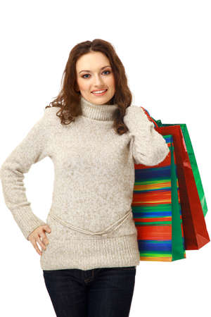 shoppingbag: Portrait of an young woman holding several shoppingbag Stock Photo