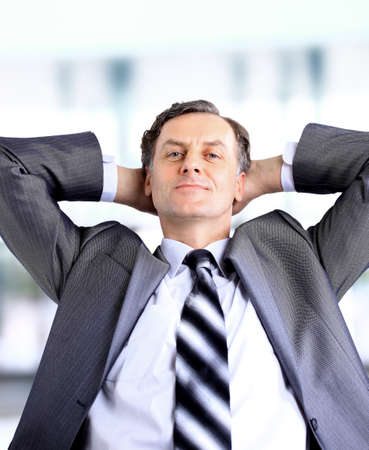 relaxed and dreaming business man sits on office chair  Stock Photo - 11148098