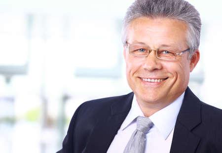 1 mature man: Portrait of a happy senior business man smiling