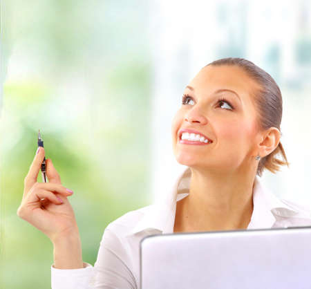 Happy cute brunette looking away with a smile Stock Photo - 11148152