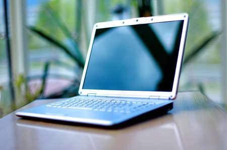 thin laptop on office desk Stock Photo - 11211327