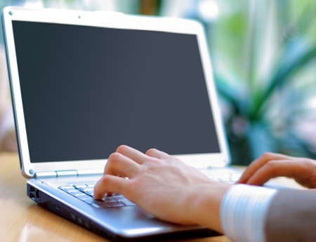 pc monitor: Person Typing on a modern laptop in an office