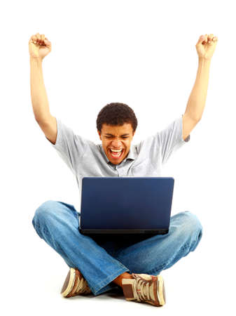 Happy young man working on a laptop, isolated against white background Stock Photo - 11211303