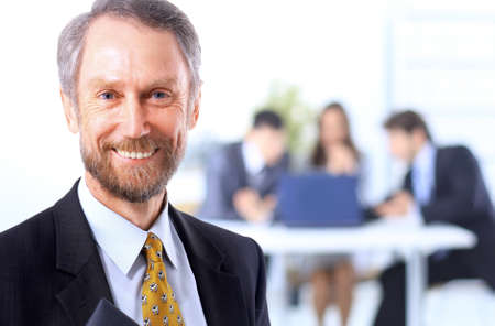 Successful business man standing with his staff in background at office Stock Photo - 11211291