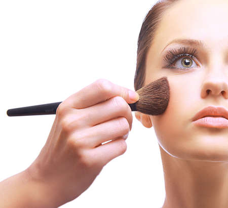 blush:  Portrait of attractive young woman applying blusher Stock Photo