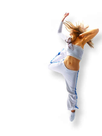 attractive young woman dancing, hair flying photo