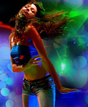 woman dancing: Beautiful young woman dancing in the nightclub  Stock Photo