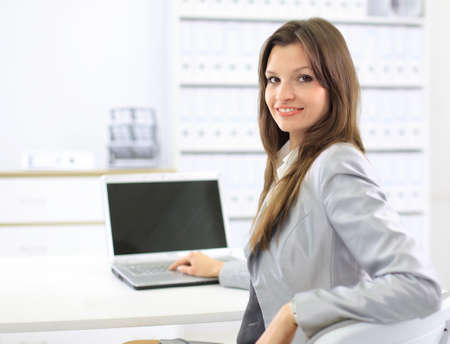business woman showing blank laptop photo