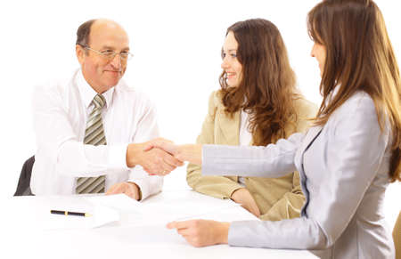 strong growth: Business people shaking hands, finishing up a meeting