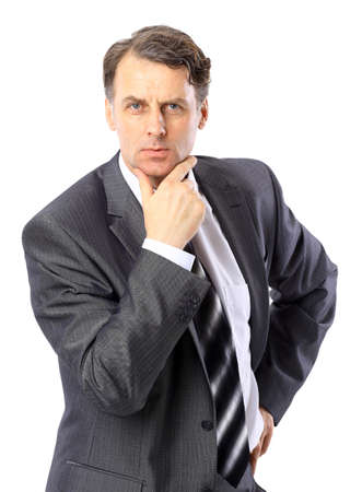 Portrait of a successful mature business man standing with folded hand on white background  photo