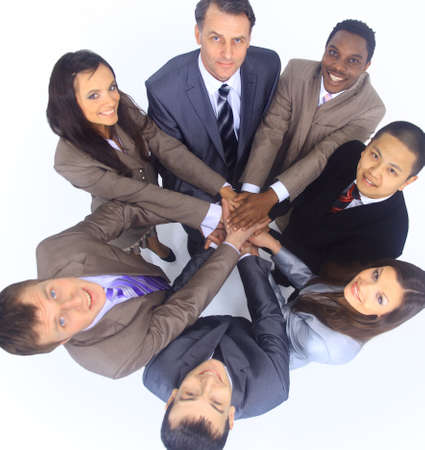 oath: Group of business colleagues with their hands together