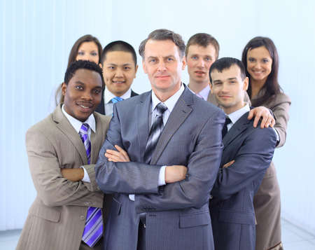 white color worker: Group of co-workers standing in office space smiling