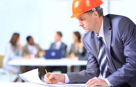 executive helmet: A handsome business construction man on the work site  Stock Photo
