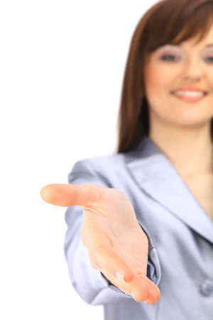 Portrait of a woman with an open hand ready to seal a deal  photo