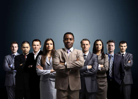 business team formed of young businessmen standing over a dark background  Stock Photo - 11315008