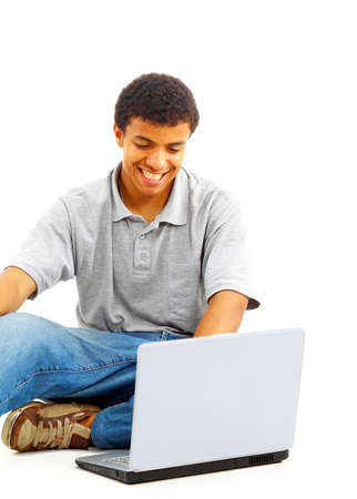 Happy young man working on a laptop, isolated against white background Stock Photo - 11314954