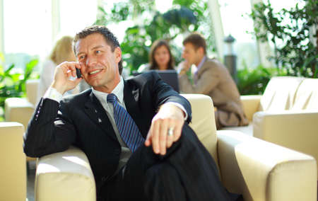 business man speaking on the cell phone while in a meeting Stock Photo - 11314991