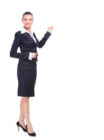 business woman standing: portrait of a pretty young business woman standing isolated on white background