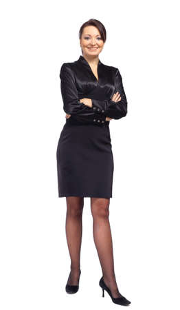 folded hands: Full length portrait of a beautiful business woman standing with hands folded over white background