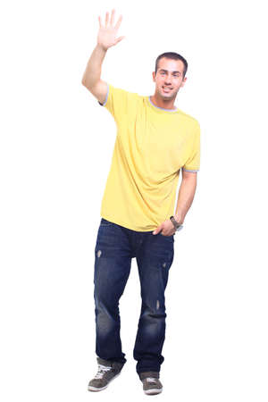 arms raised: Full length portrait of a stylish young man standing with hands in pockets over white background  Stock Photo