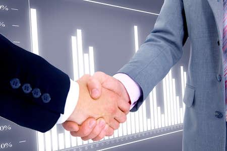 commerce: poign�e de main isol� sur fond d'affaires Banque d'images