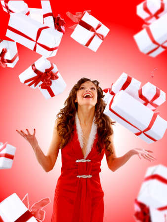 Excited attractive woman with many gift boxes and bags.  photo